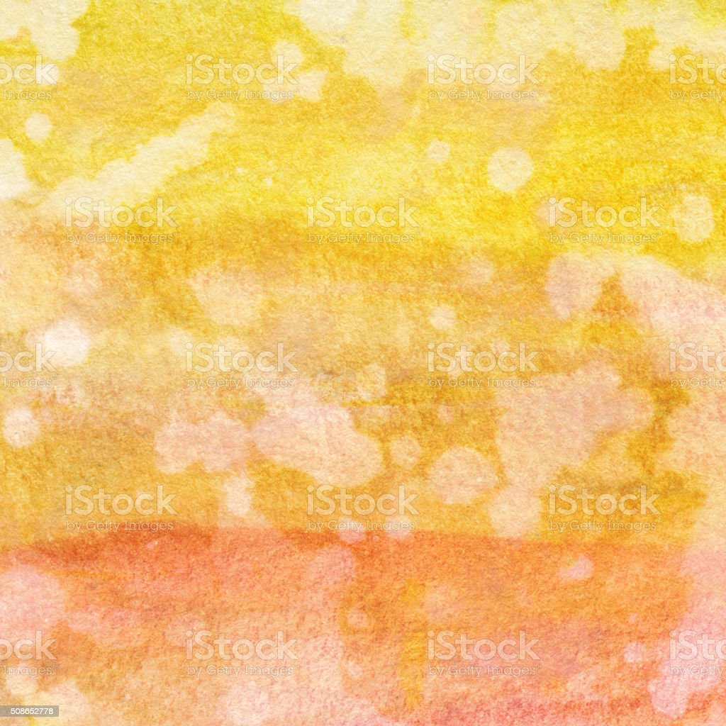 Vibrant orange and yellow hand painted background on paper stock photo