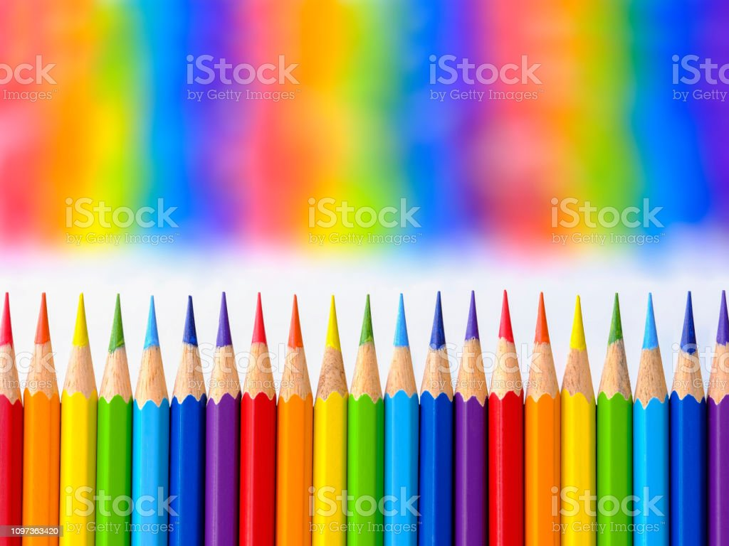 Vibrant rainbow colored water color coloring pencils or crayons in a...
