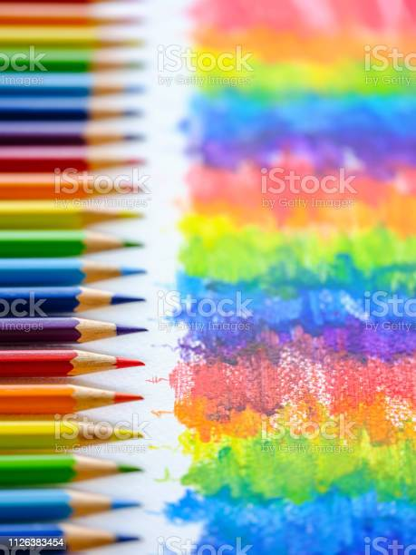Vibrant Rainbow Colored Water Color Coloring Pencils Or Crayons In A Row Standing Vertically With Corresponding