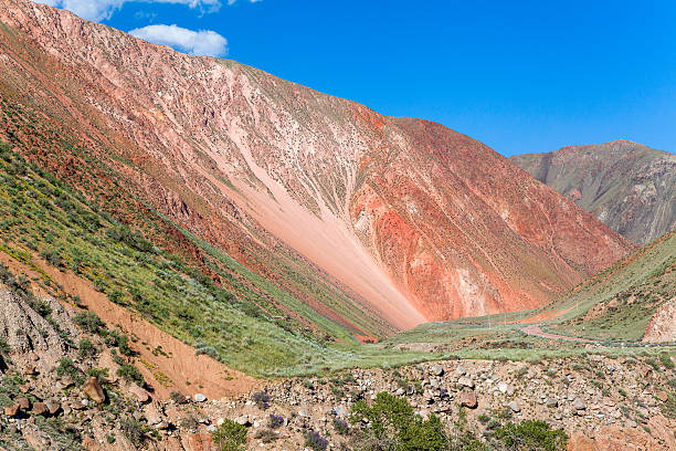 Vibrant red colored mountain in Kyrgyzstan stock photo
