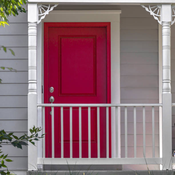 Vibrant red front door and balcony of a home stock photo