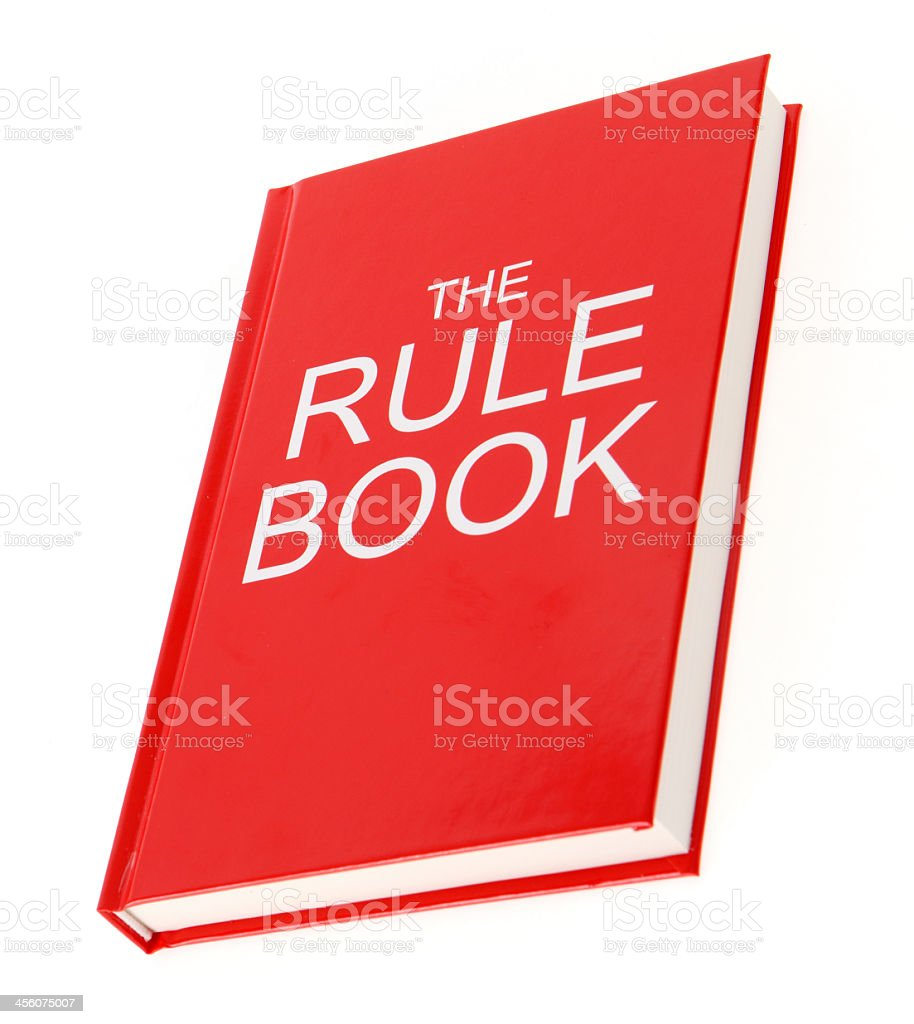 A vibrant red Rule Book isolated on a white background royalty-free stock photo