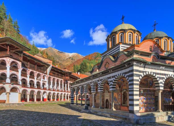Vibrant Rila monastery with blue sky stock photo
