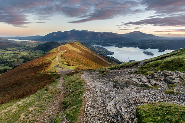 Vibrant sunrise at Catbells in the English Lake District. Autumn vibrant sunrise on Catbells in the English Lake District. english lake district stock pictures, royalty-free photos & images