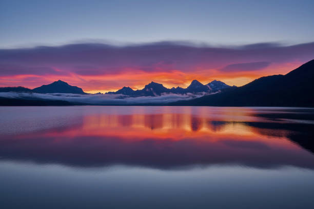 Vibrant Sunrise in the Beautiful Natural Scenery of Glacier National Park's Lake McDonald Area During the Summer in Montana, USA. stock photo