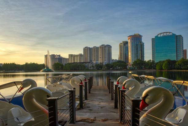 Vibrant Sunrise Over Lake Eola Park and the Orlando Skyline in Downtown Orlando Florida USA stock photo