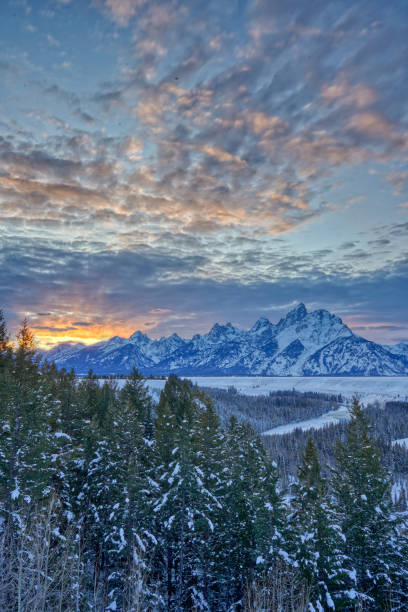 Vibrant Sunset in the Winter at Christmas in the Grand Tetons National Park and Yellowstone National Park USA stock photo