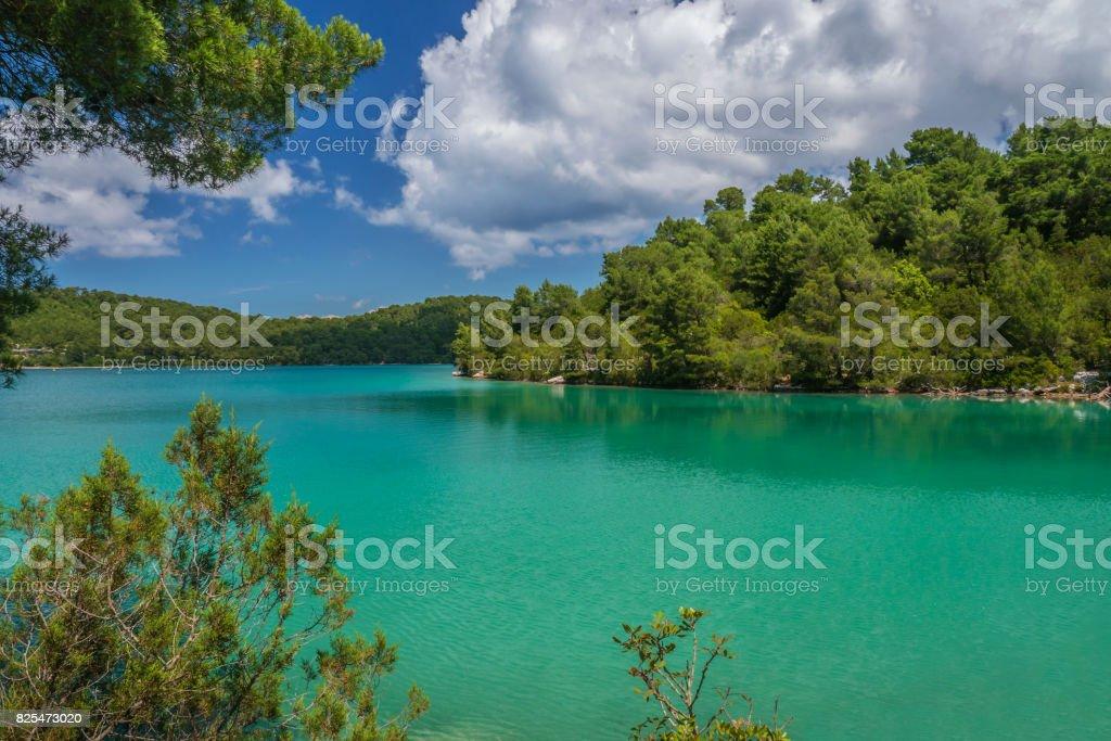Vibrant turquoise color water of inland saltwater lake on Mljet island, on Croatia's Dalmatian coast on the Adriatic Sea. stock photo