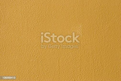 1084390994istockphoto Vibrant Yellow Painted Wall 106569413