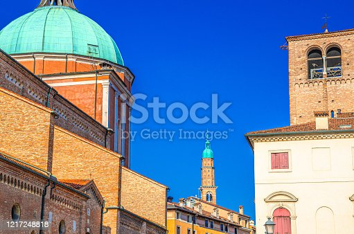istock Vicenza Cathedral Roman Catholic church building dome and Torre Bissara clock tower background, old historical city centre of Vicenza city, blue sky background, Veneto region, Italy 1217248818
