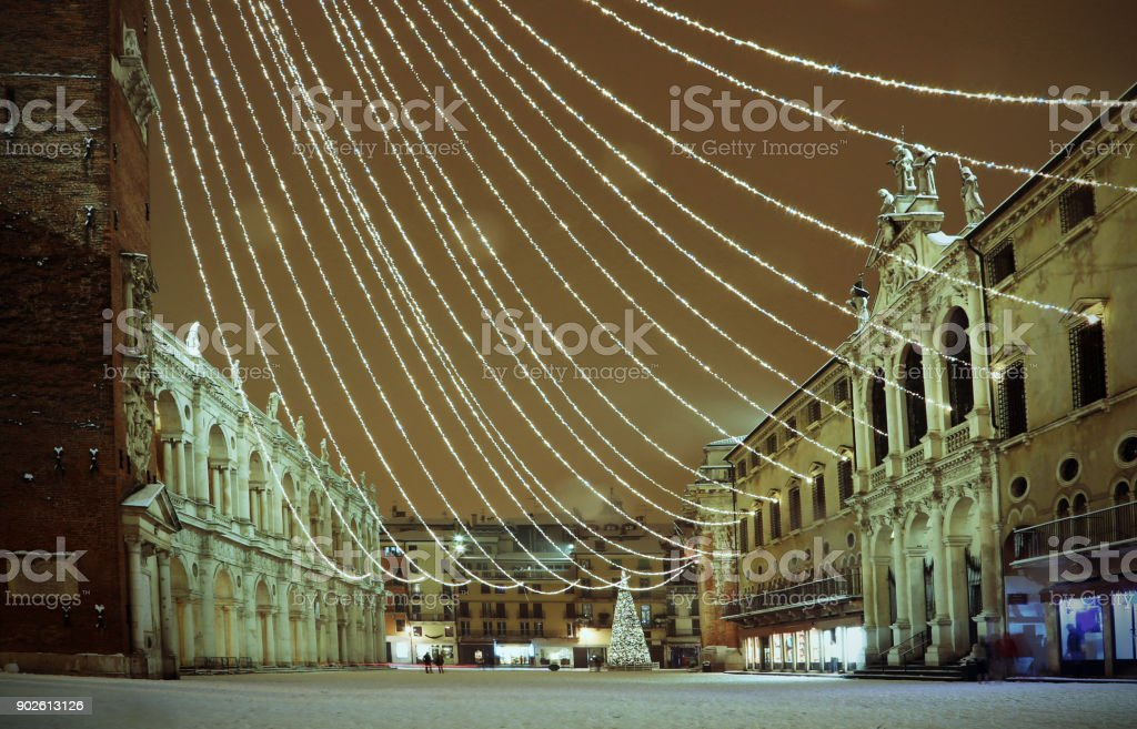 Vicenza in Italy by night. the main Square called Piazza dei Signori with snow and Christmas lights with vintage effect stock photo