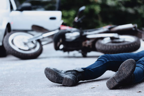 Victim of motorbike accident Victim of a motorbike accident lying on the street unconscious crash stock pictures, royalty-free photos & images