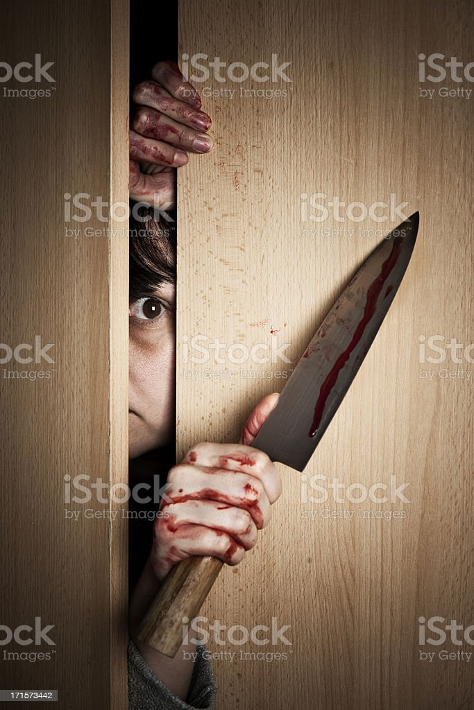 Victim or Killer with Bloody Knife royalty-free stock photo