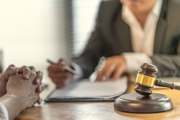 Victims claim with a lawyer about unfair contracts in purchasing homes Victims claim with a lawyer about unfair contracts in purchasing homes lawsuit stock pictures, royalty-free photos & images