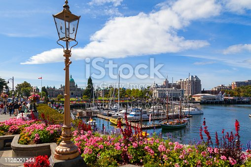 Victoria B.C. Canada Aug 27, 2016: People at one of the waterfront Bastion Square in the City of Victoria. The city's charm and new world experiences. As an island destination, Victoria offers visitors an escape from the hurried world and beams with the ambiance