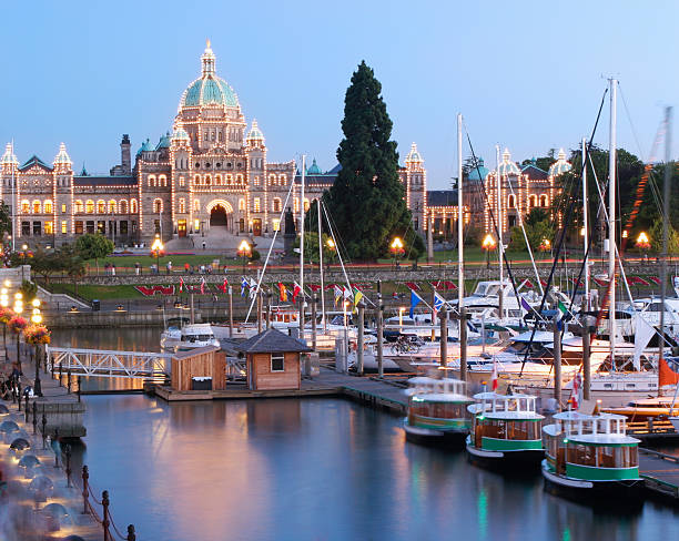 Victoria at Dusk, British Columbia Inner Harbor and Parliament Building of British Columbia at dusk vancouver island stock pictures, royalty-free photos & images