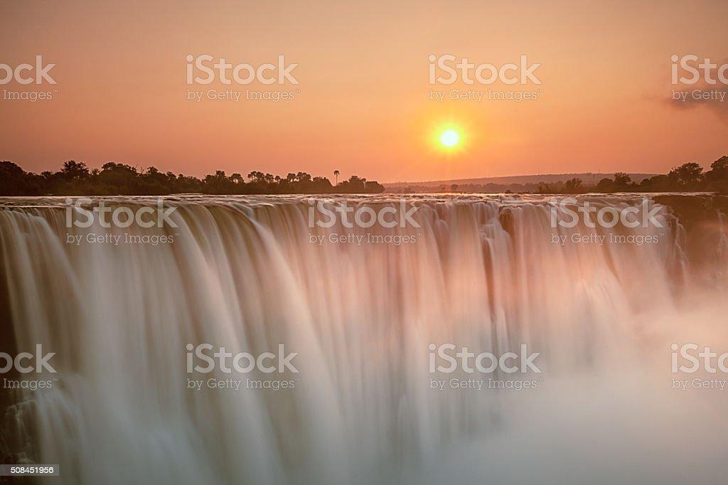 Victoria falls at sunrise stock photo