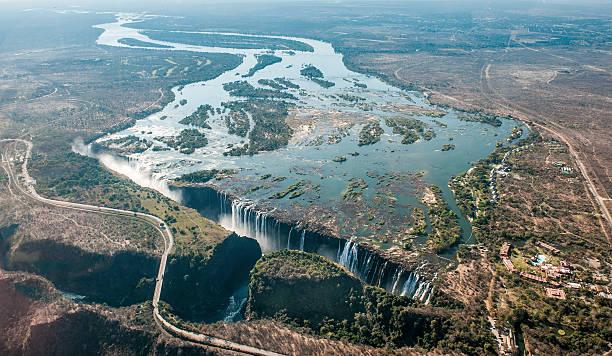 victoria falls on helicopter. - sambia stock-fotos und bilder