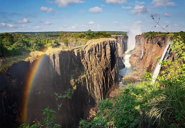 victoria falls, sambia und regenbogen - sambia stock-fotos und bilder