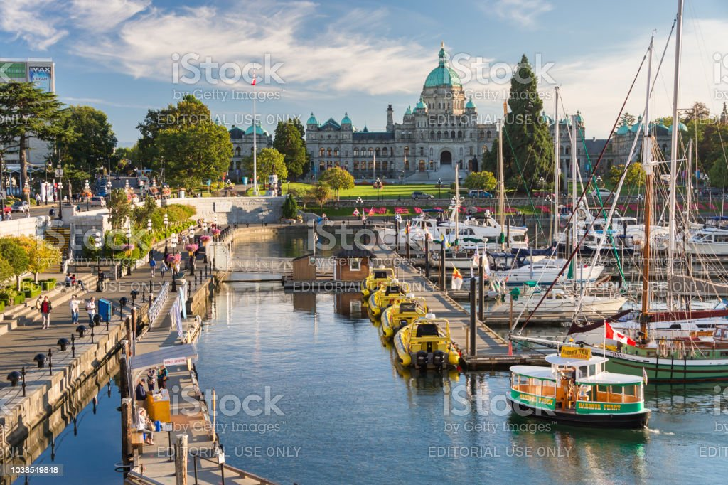 Victoria Harbour and British Columbia Parliament Buildings at sunset stock photo