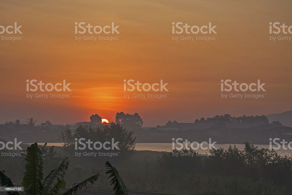 Victoria Lake at hazy dawn with rising Sun in horizon stock photo