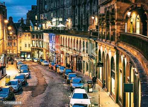 A view of the historic curving Victoria Street in the centre of Edinburgh's ancient Old Town.