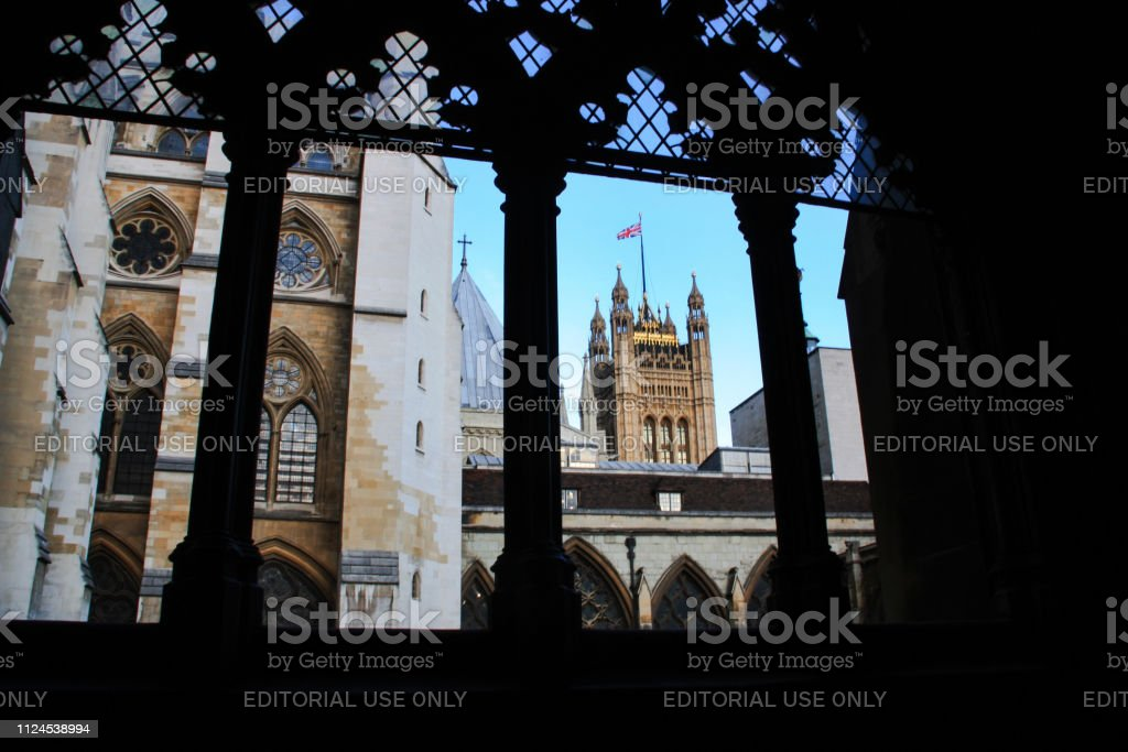 Victoria Tower of the Westminster Palace in London, United Kingdom, seen from Westminster Abbey's colonnade stock photo