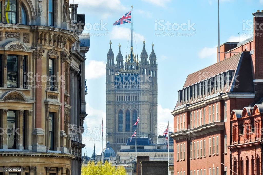 Victoria tower of Westminster palace seen from Trafalgar square, London, UK stock photo