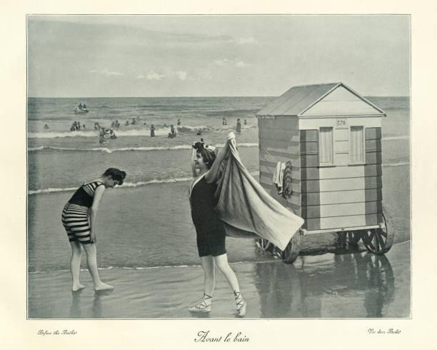 Victorian Bathing machine, women in swimwear, seaside, 19th Century stock photo