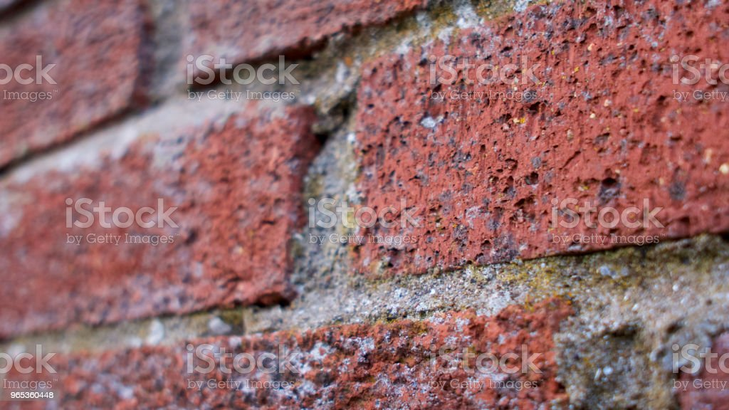 Victorian brickwork path and older style stone wall royalty-free stock photo
