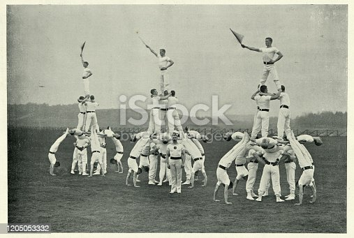Vintage photograph of Victorian british army, Gymnastic team, Living pyramids display by the training staff at Aldershot gymnasium. 1890s.  19th Century