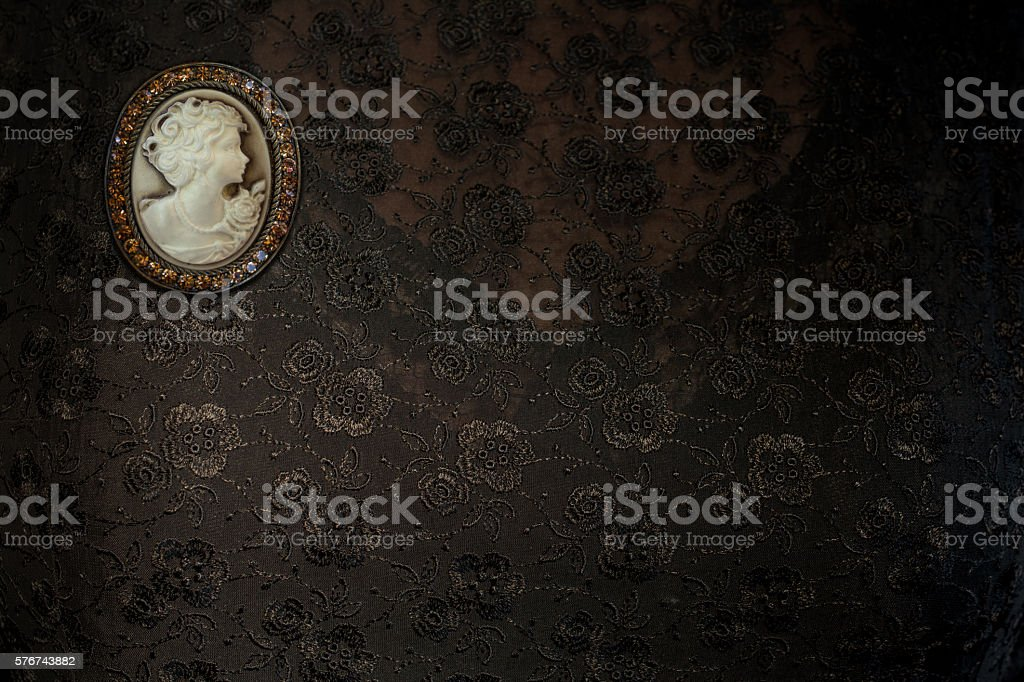 Victorian Cameo Brooch with a woman  portrait on lace dress stock photo