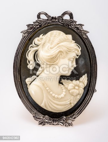 861629426 istock photo Victorian cameo of a young woman 940542362