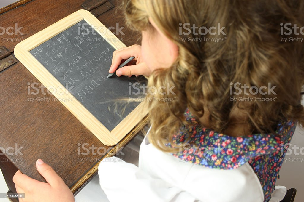 victorian child working at a school desk royalty-free stock photo