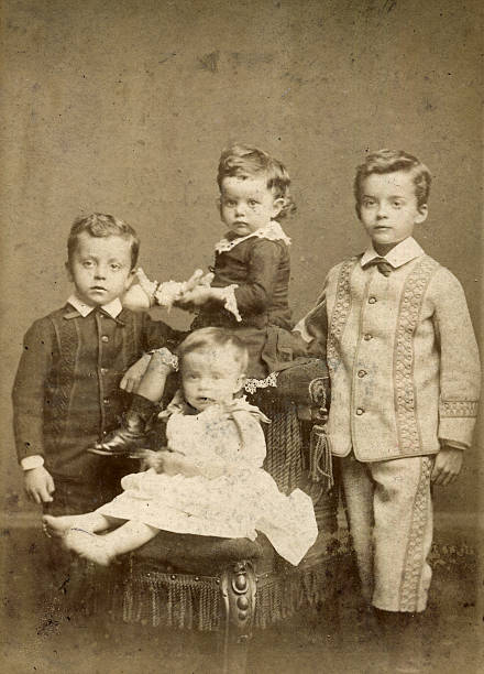 Victorian Children - 4 Brothers and Sisters Victorian Children, very young 2 sisters and 2 brothers. Photographs of they are growing up is also available. 1880 stock pictures, royalty-free photos & images