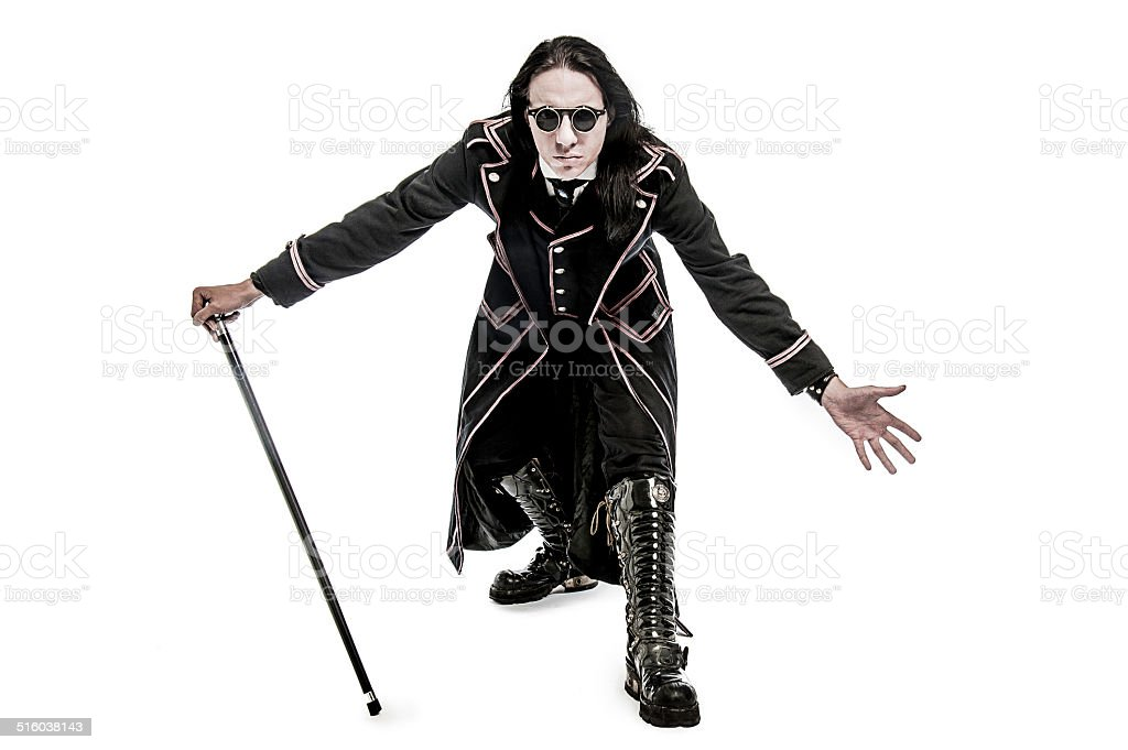 Victorian costume character with Cane and Leather Boots stock photo