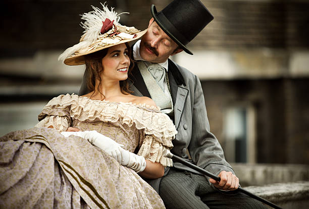 Victorian couple in love having a good time together Victorian couple in love having a good time together, young smiling woman looks happy, men looking at her. 19th century stock pictures, royalty-free photos & images