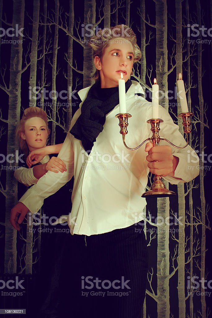 Victorian Era Young man Holding Candlestick and Leading Woman royalty-free stock photo