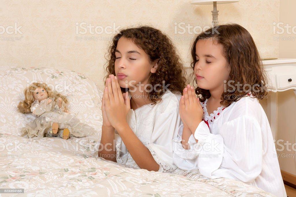 Victorian girls praying stock photo