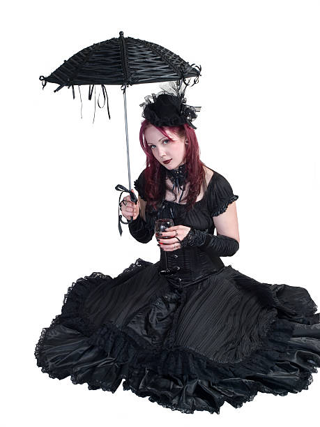 Victorian Gothic Girl - Seated with Parasol and Wine stock photo