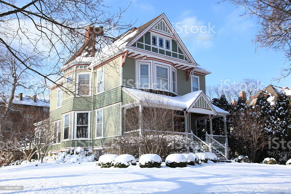 Victorian House Covered in Snow stock photo