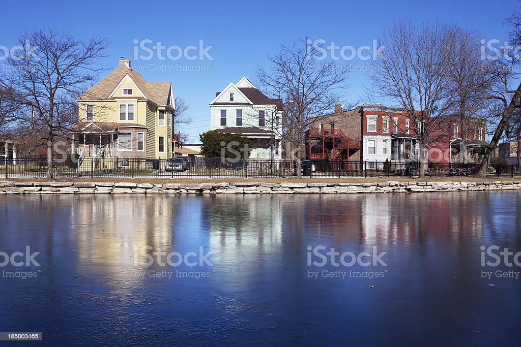 Victorian Houses reflected in frozen pond, Auburn Park, Chicago royalty-free stock photo
