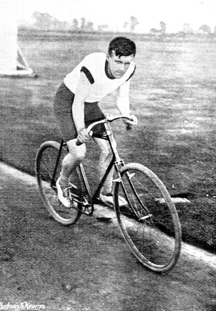 Victorian image of a man riding his bicycle in a race; 19th century cycling; from The Navy and Army Illustrated 1899 stock photo