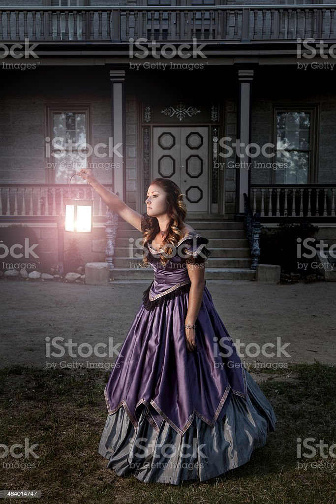 Victorian Lady Searching outside a Mansion royalty-free stock photo