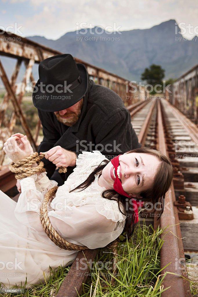 Victorian melodrama als wicked Schurke Krawatten maiden die Bahngleise – Foto