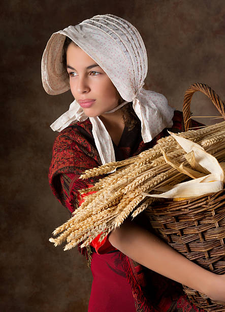 Victorian peasant girl Reenactment image of a victorian peasant girl holding a basket bonnet stock pictures, royalty-free photos & images
