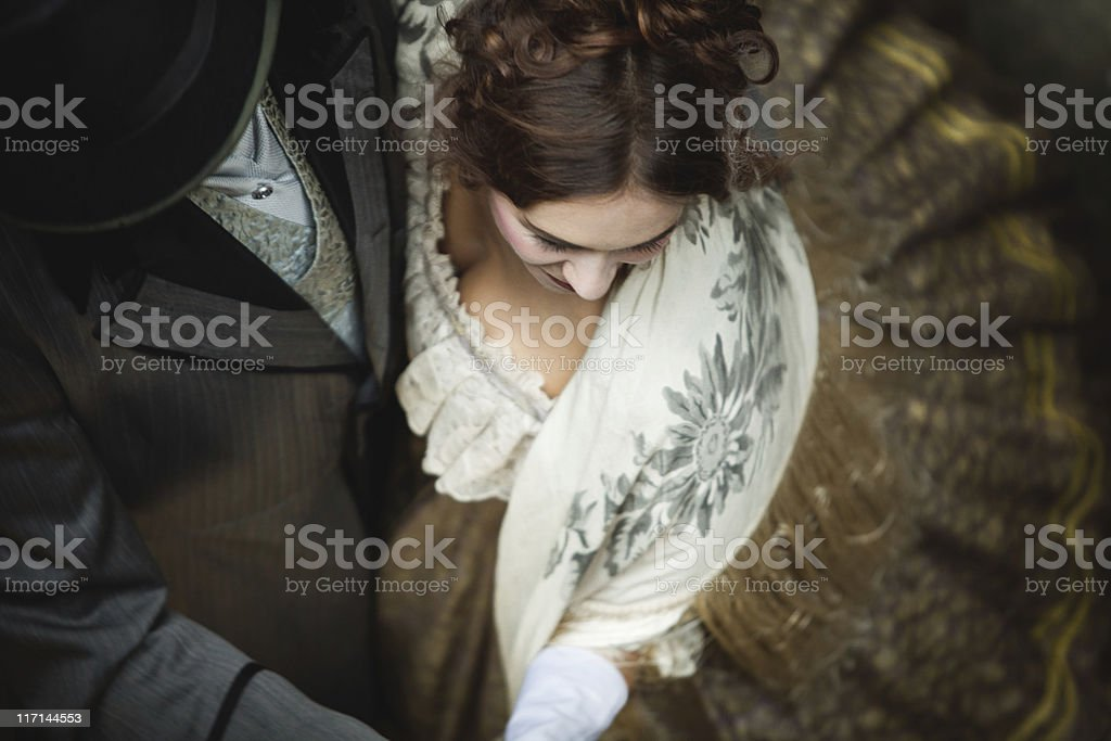Victorian romantic couple whirls while dancing together. stock photo