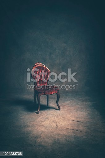 A studio portrait of a lone victorian style chair.