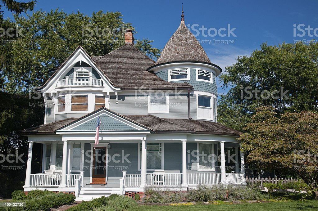 A Victorian style home with wrap-around porch stock photo