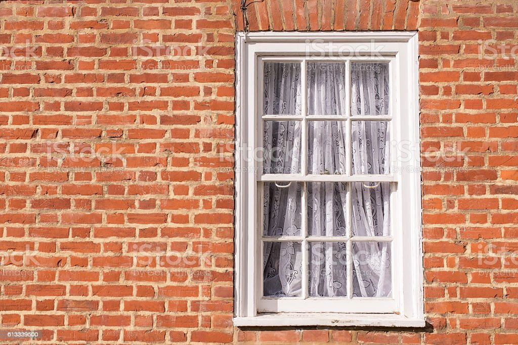 Victorian wooden frame white sash window with glass panels stock photo